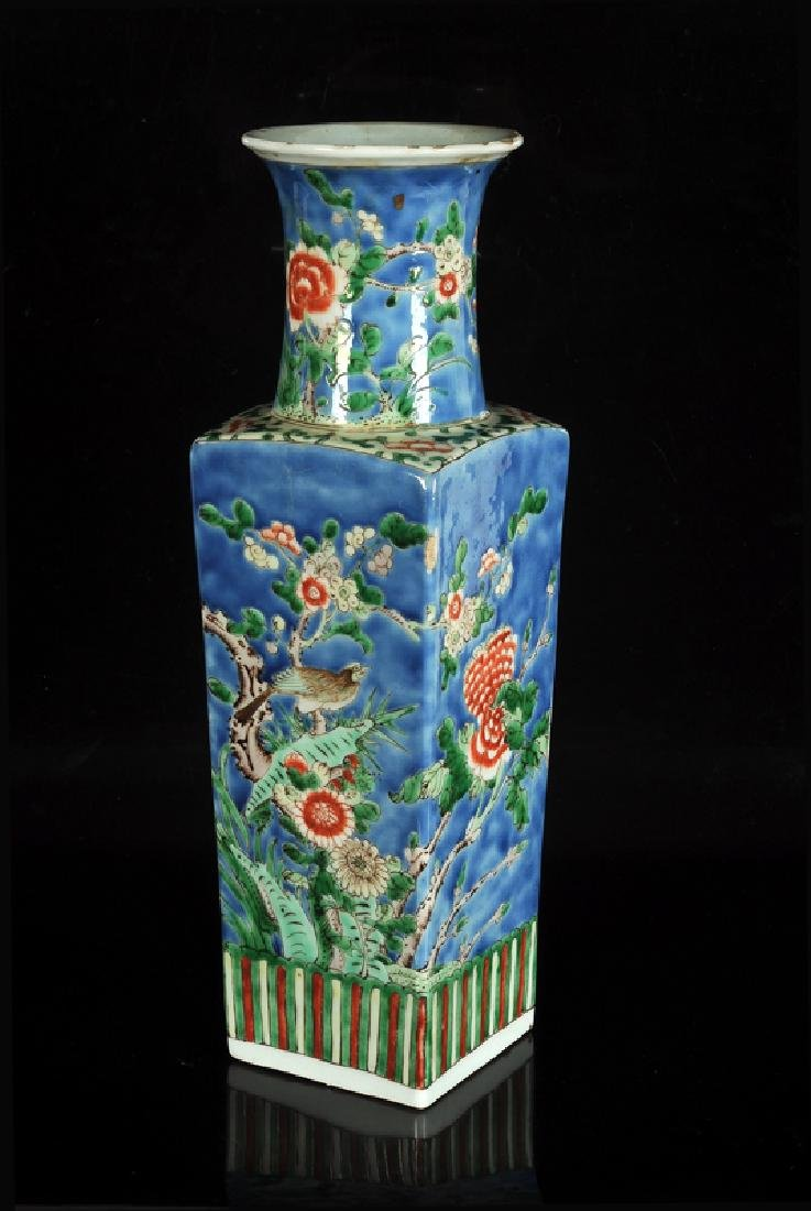 A square polychrome porcelain vase with circular neck