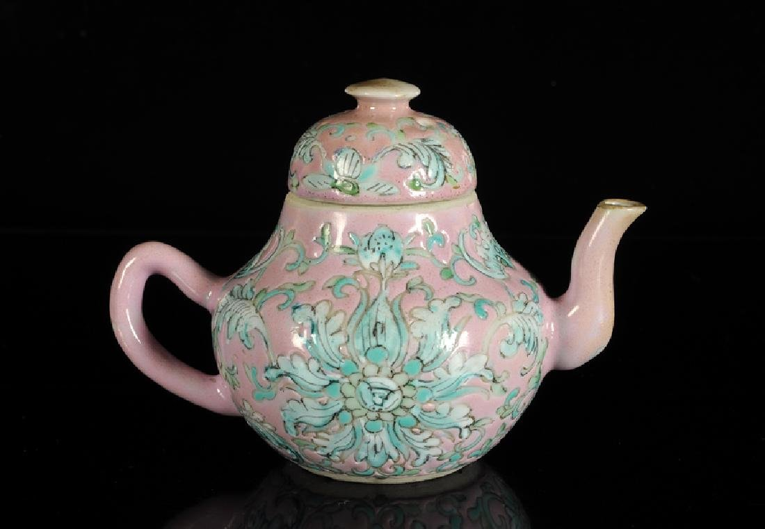 A polychrome teapot with pink fond, decorated with - 2