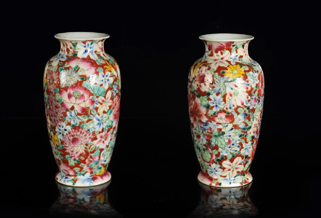 A pair of polychrome porcelain Mille Fleurs vases.