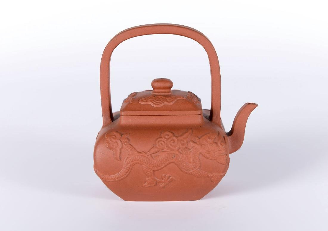 A square-shaped Yixing teapot decorated with dragons. - 3