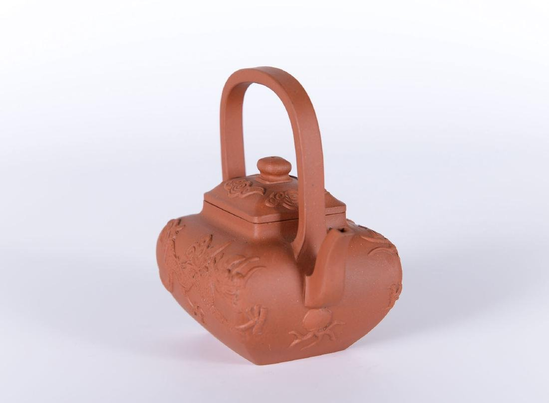 A square-shaped Yixing teapot decorated with dragons. - 4