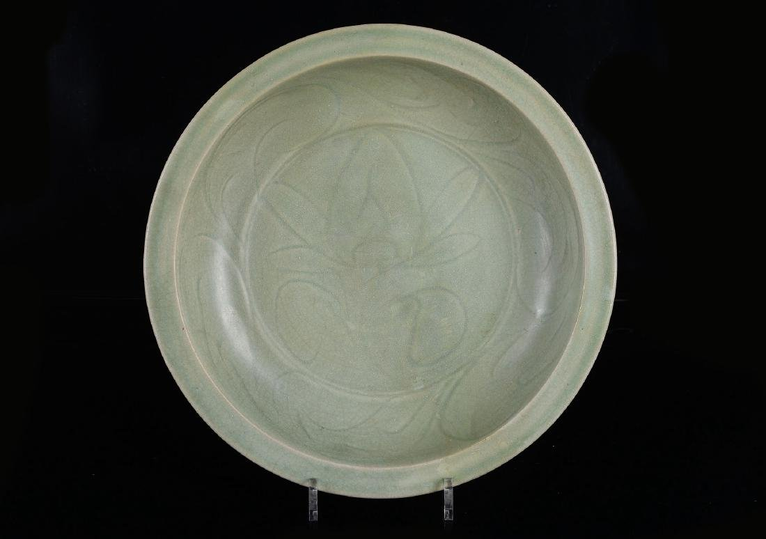 A Longquan celadon charger with floral decor. Unmarked.