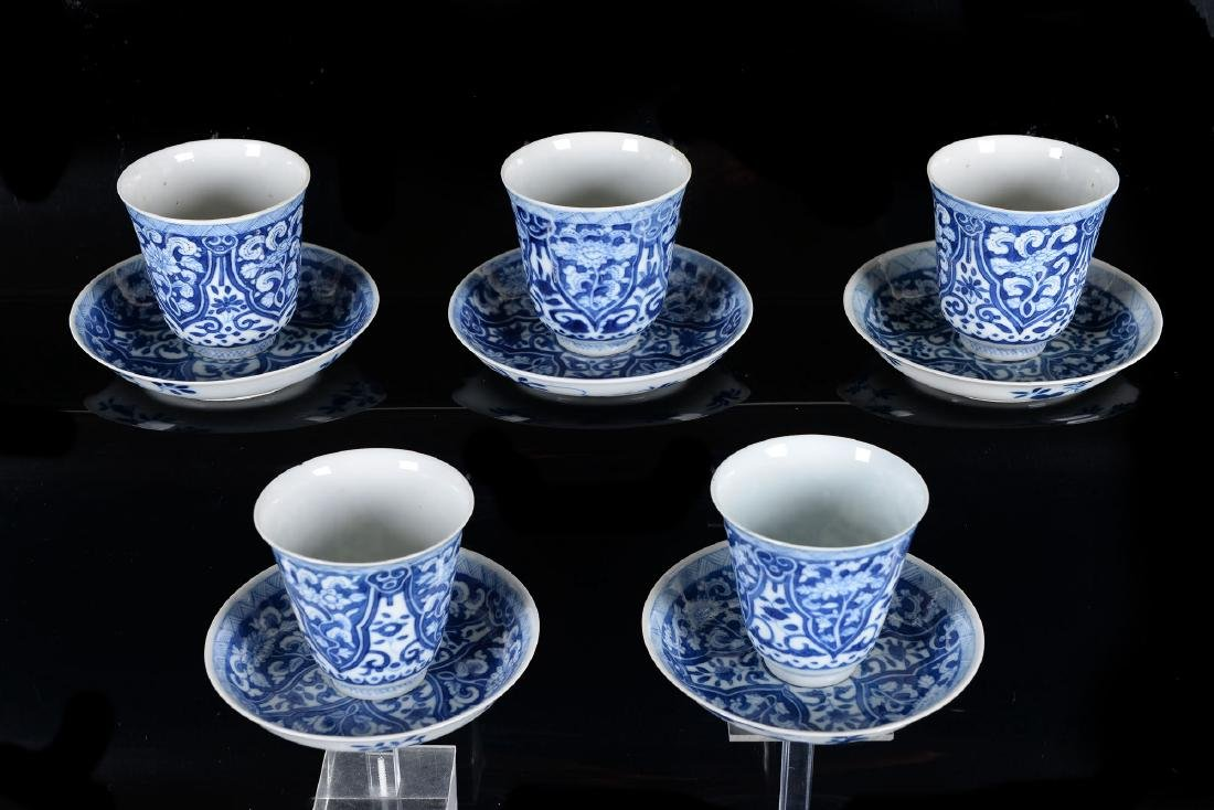 Lot of five blue and white porcelain cups with saucers.