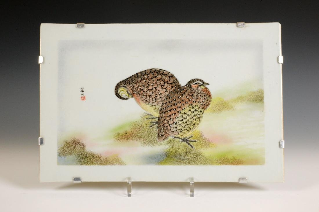 A polychrome porcelain plaque with a decor of two