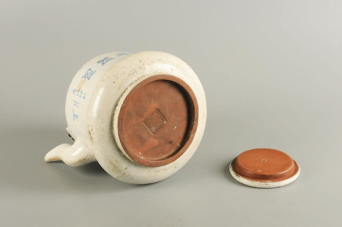 A cream glazed Yixing teapot, decorated with - 7
