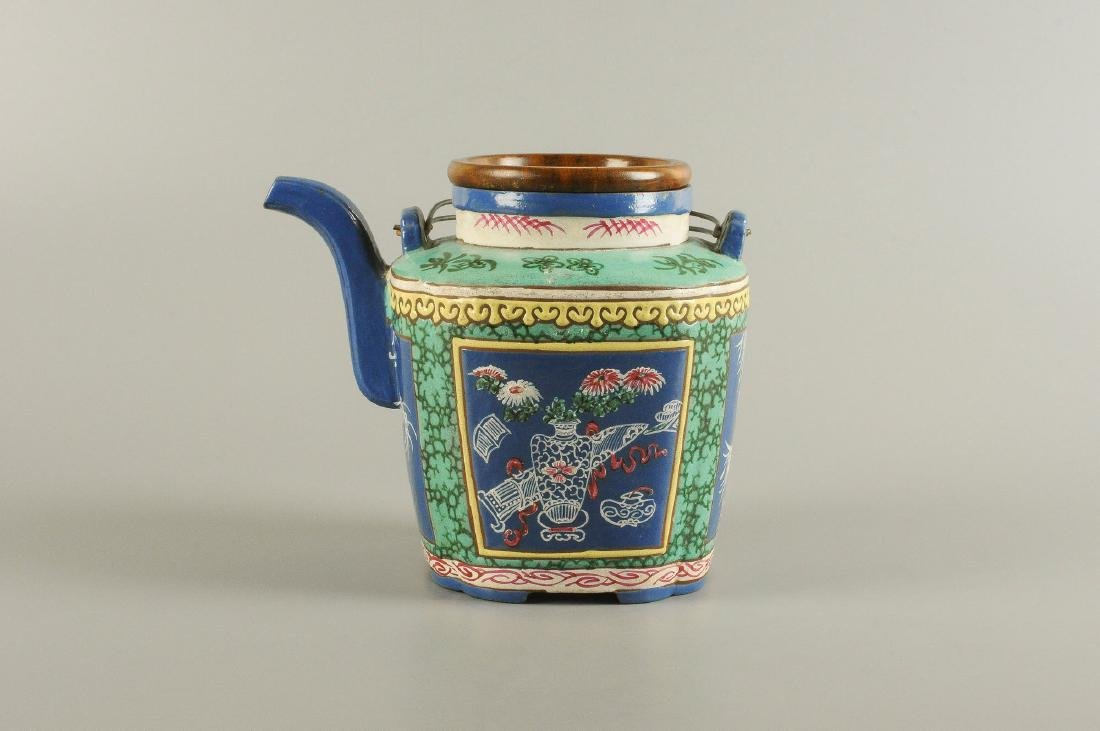 A polychrome glazed Yixing teapot, decorated with