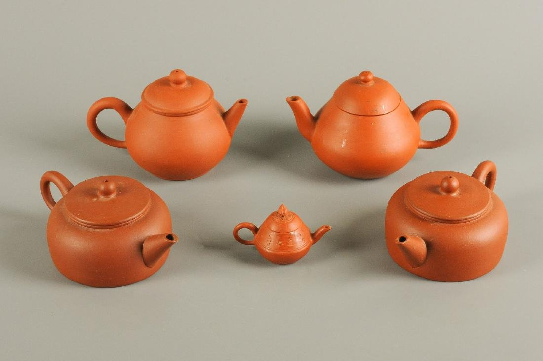A lot of five Yixing teapots. Three of them marked with
