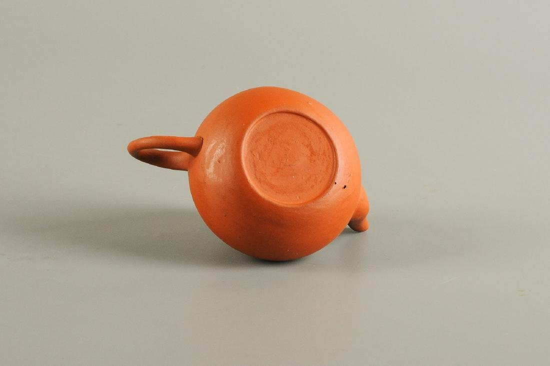 A lot of five Yixing teapots. Three of them marked with - 2