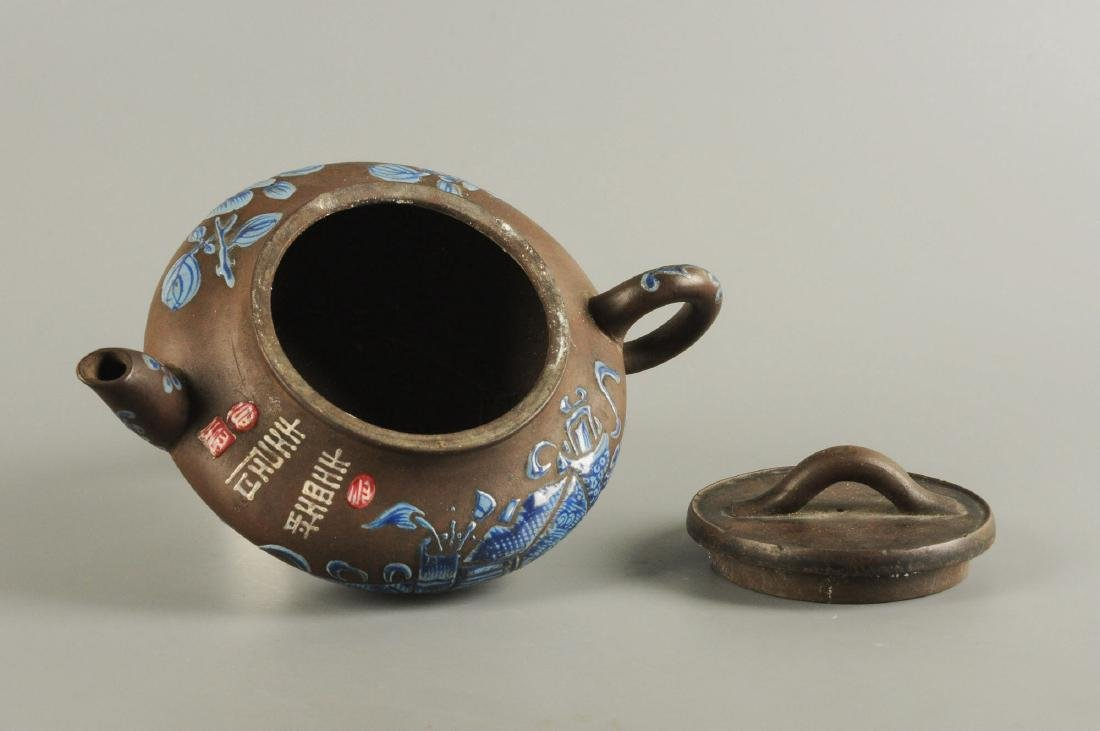 A Yixing teapot decorated with floral design. Unmarked. - 2
