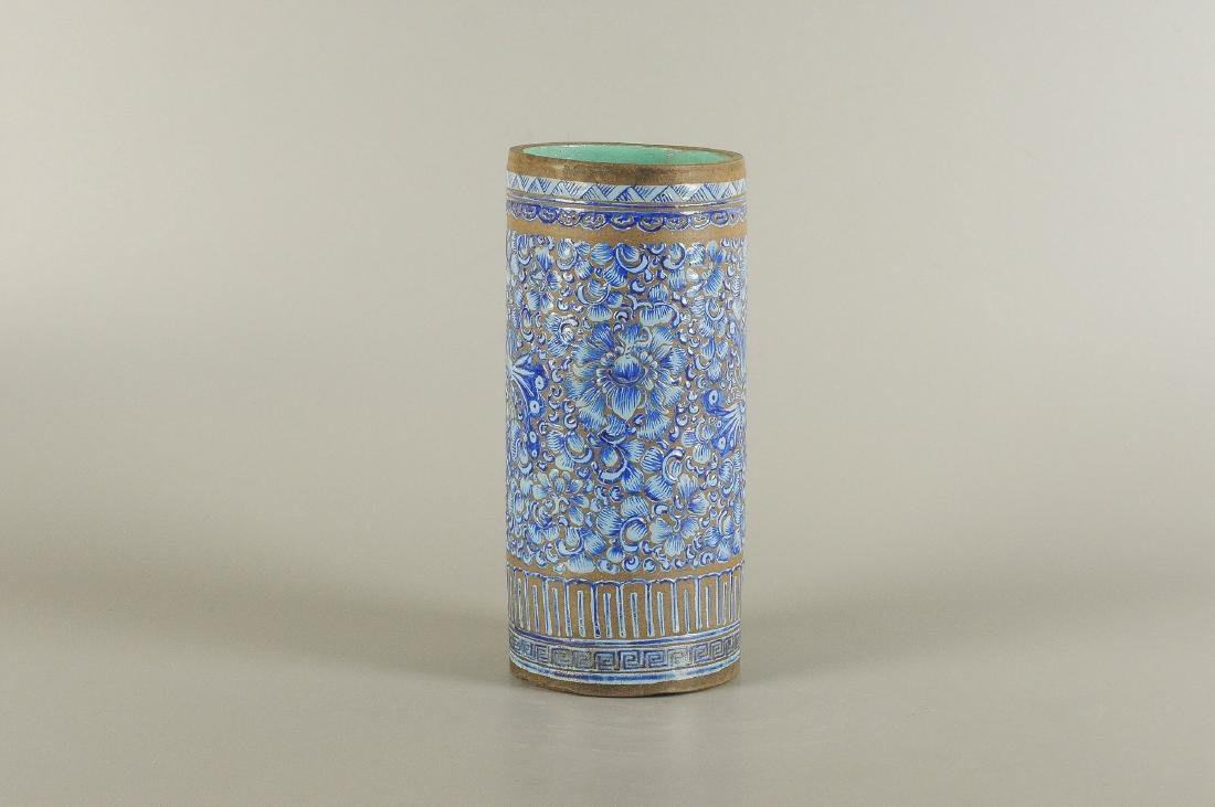 A Yixing blue glazed brush pot, decorated with floral