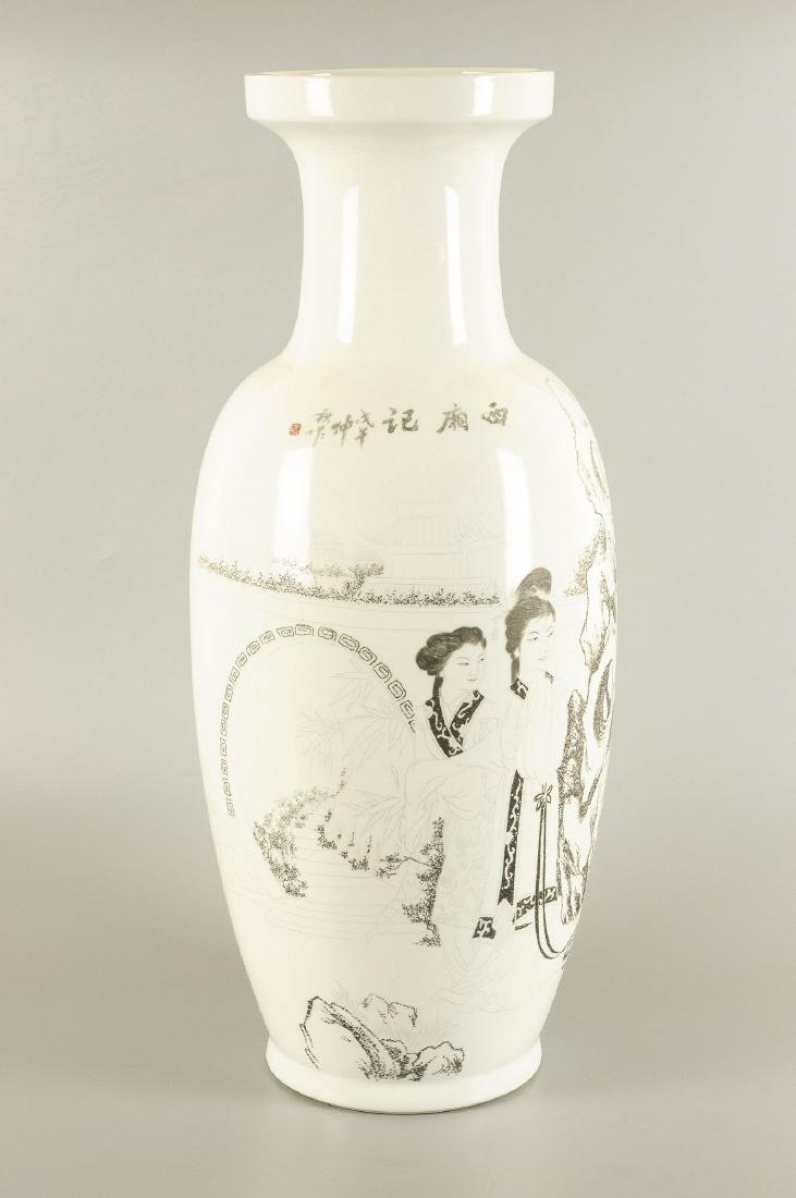 A black and white engraved porcelain vase, decorated