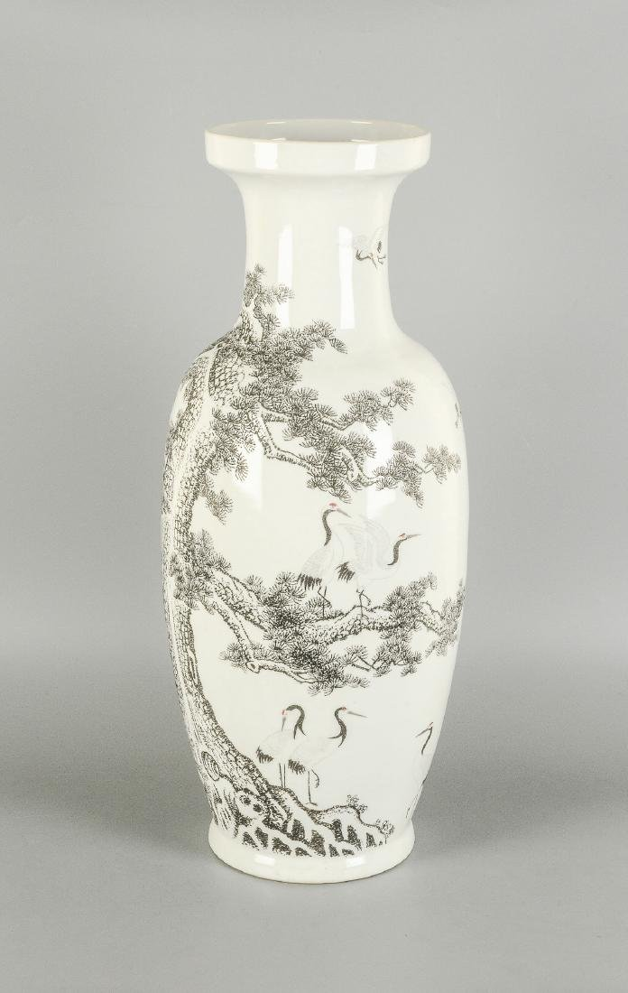 A black and white porcelain vase, decorated with floral