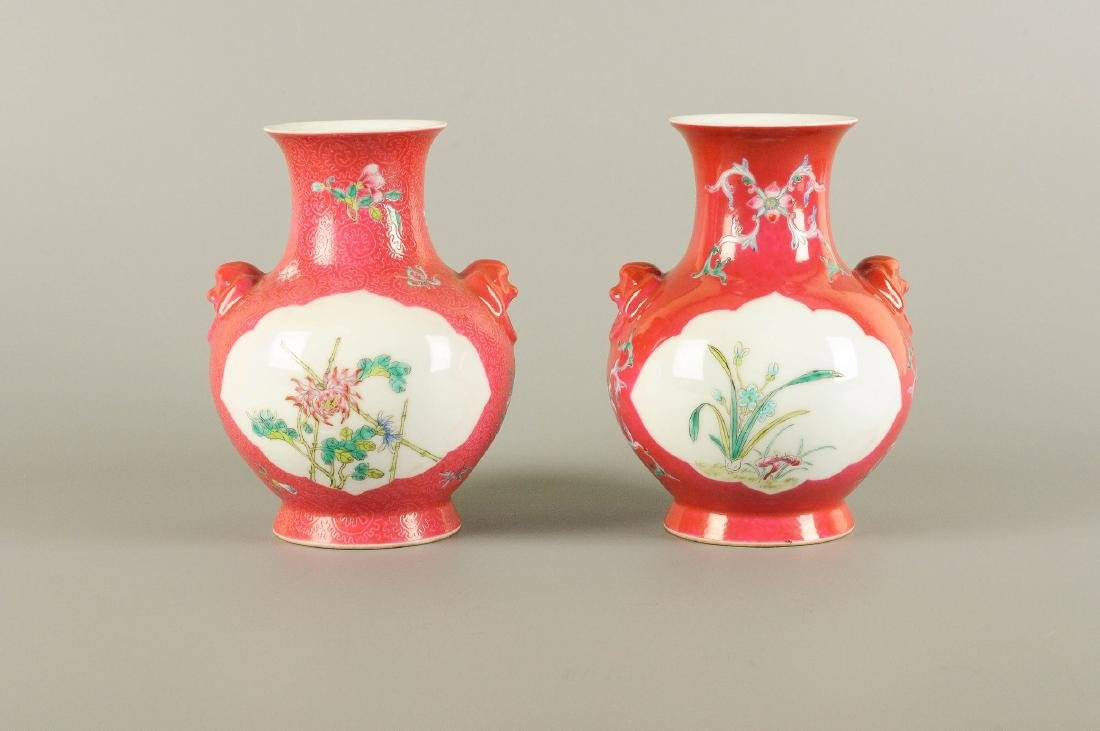 A pair of polychrome porcelain vases with an unmatching
