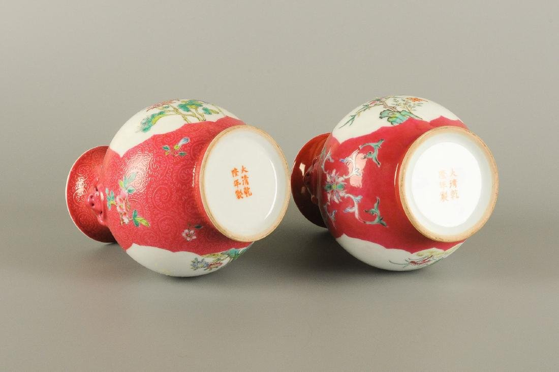 A pair of polychrome porcelain vases with an unmatching - 4