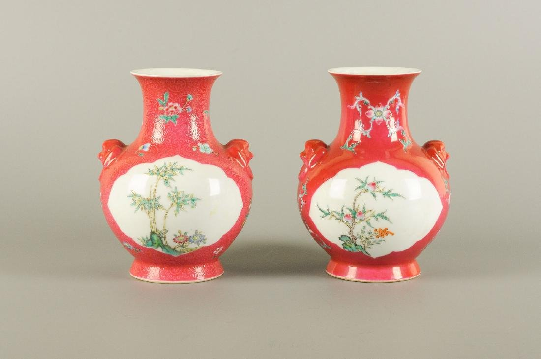 A pair of polychrome porcelain vases with an unmatching - 6