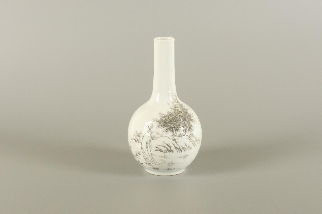 A porcelain longneck vase with a black ink decor of a