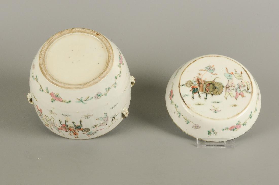 A polychrome porcelain lidded pot with thread eyes and - 2