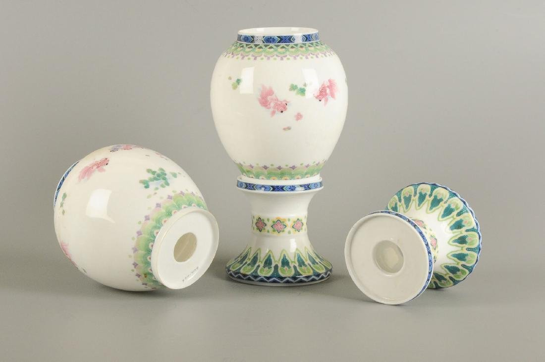 A pair of polychrome porcelain vases on a porcelain - 4