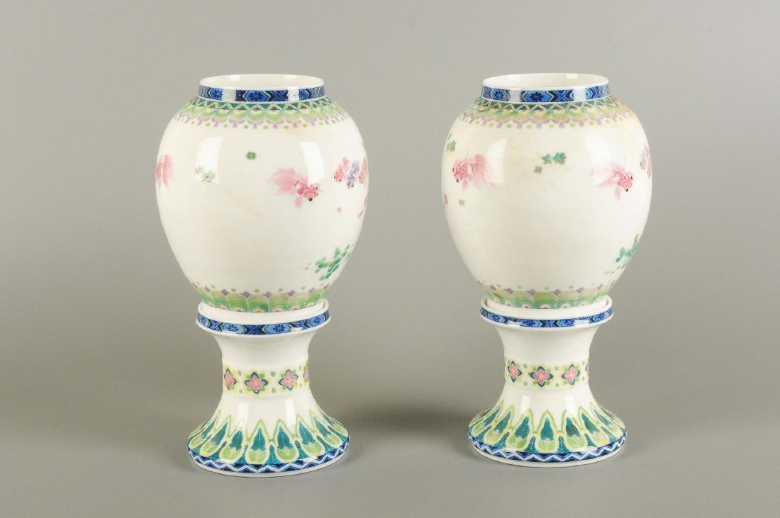 A pair of polychrome porcelain vases on a porcelain - 5