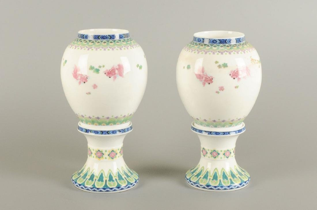 A pair of polychrome porcelain vases on a porcelain - 6