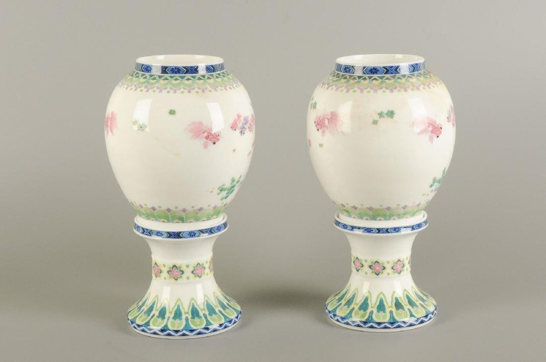 A pair of polychrome porcelain vases on a porcelain - 7