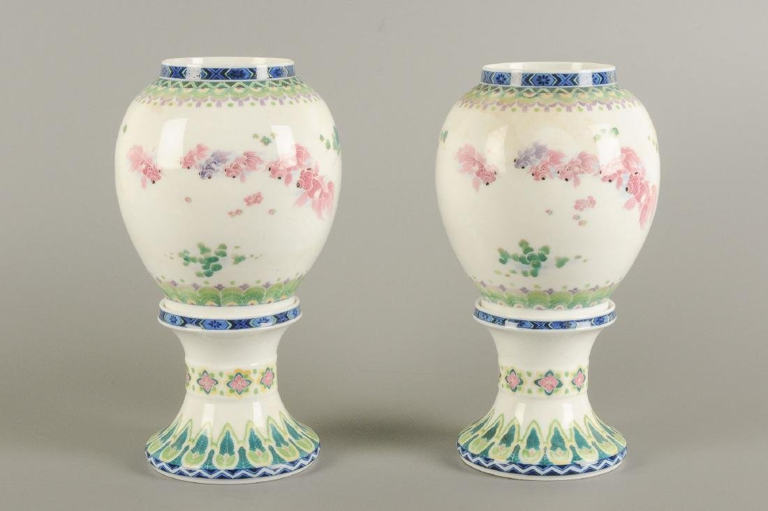 A pair of polychrome porcelain vases on a porcelain - 8