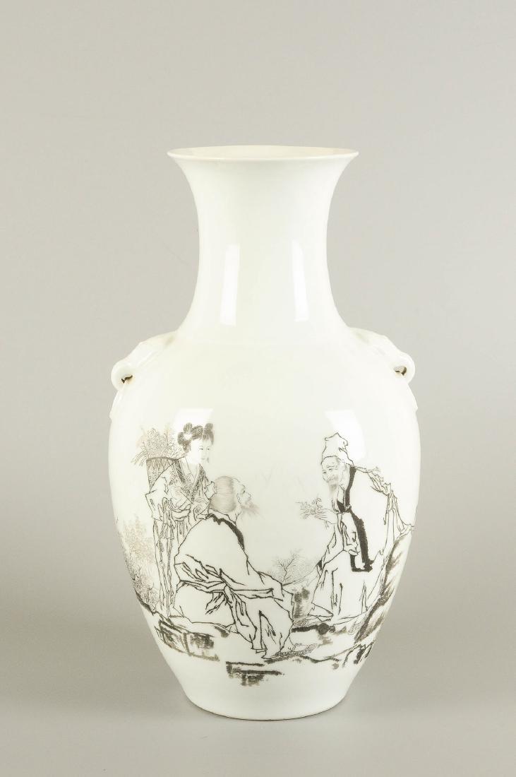 A porcelain baluster vase with a black ink decor of