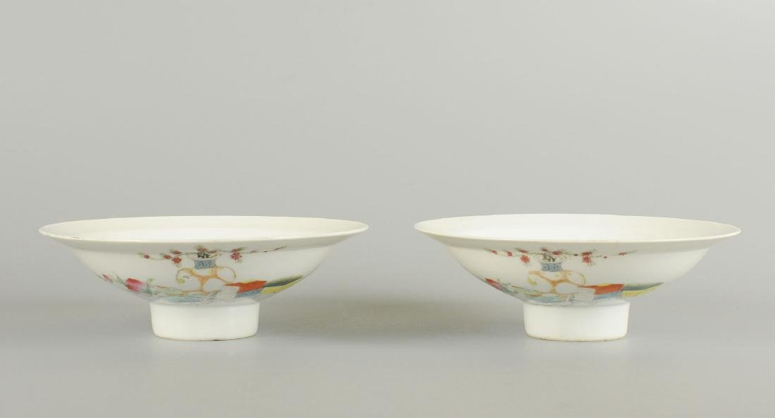 A pair of polychrome porcelain bowls on stand,