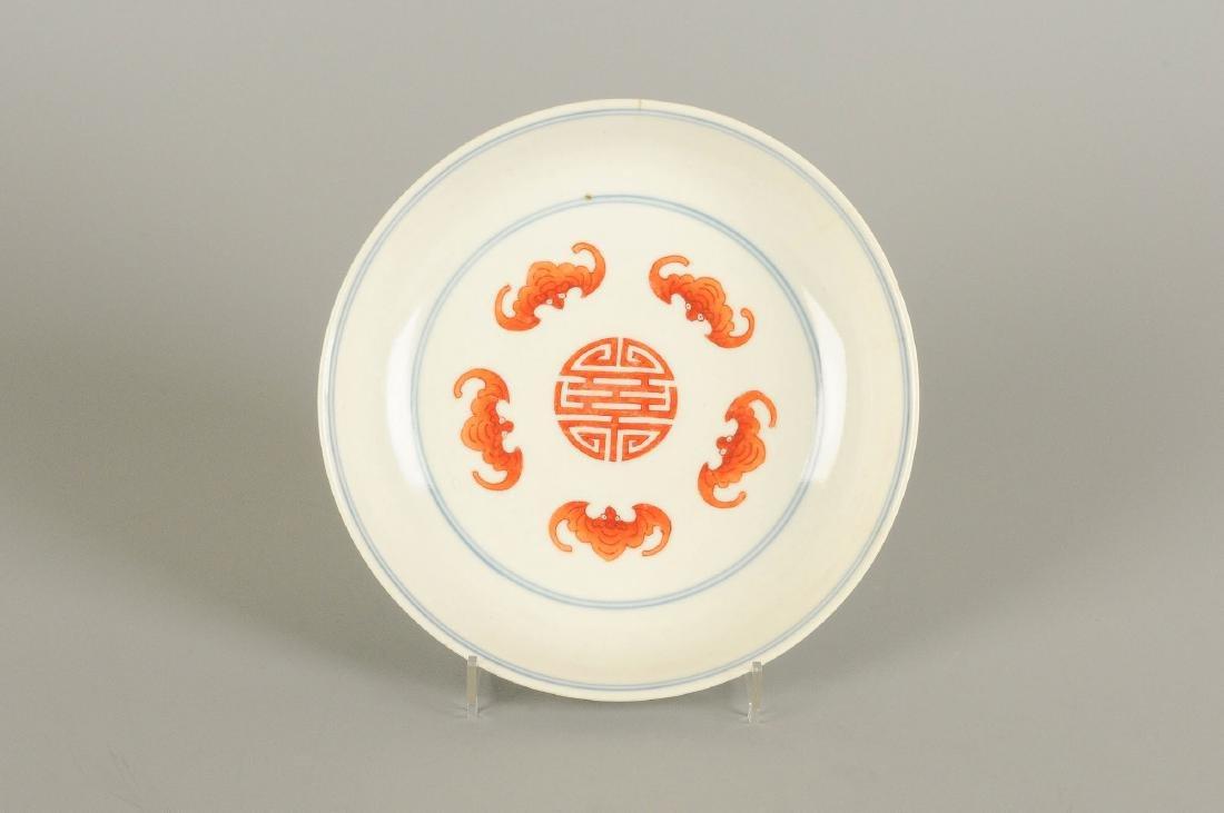 A polychrome porcelain deep plate with floral design