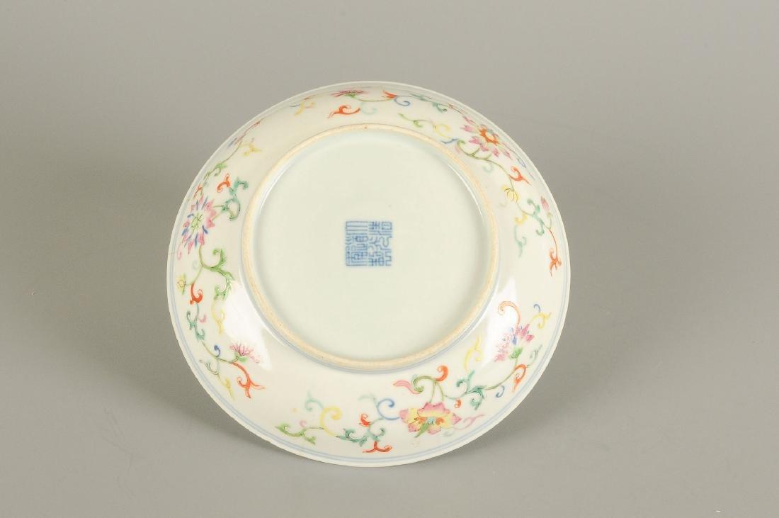 A polychrome porcelain deep plate with floral design - 2