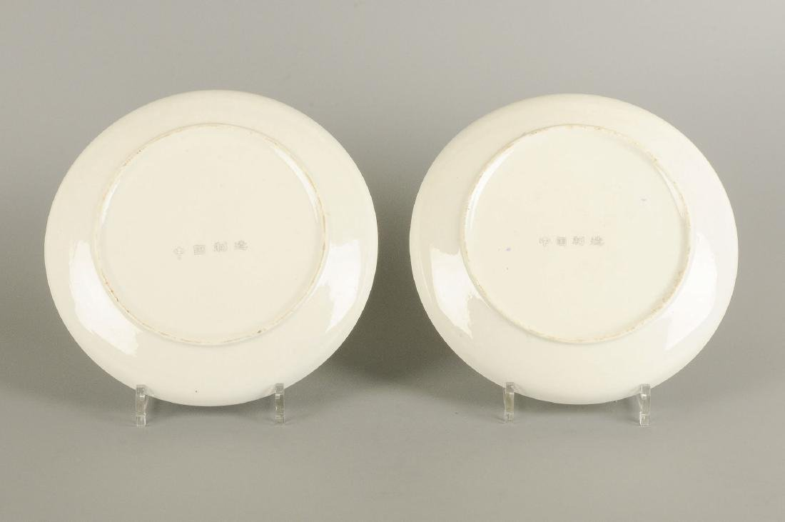 A set of 12 large plates with varying decoration, i.a. - 11