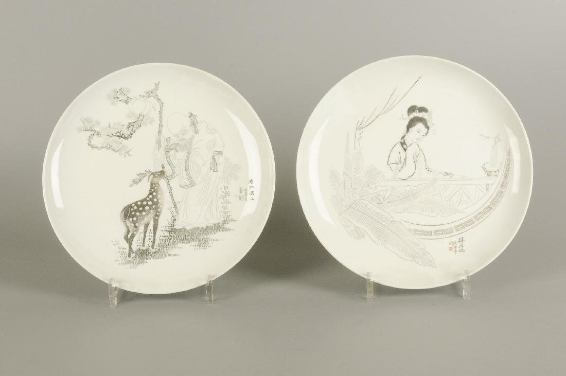 A set of 12 large plates with varying decoration, i.a. - 8