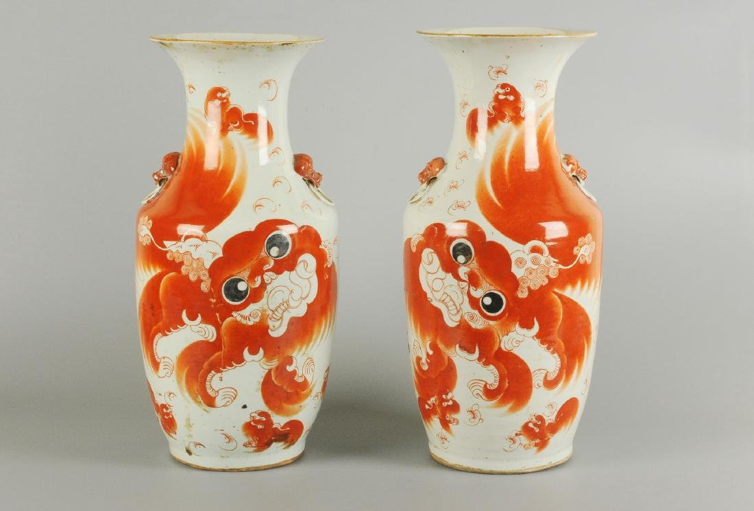 A pair of iron red vases decorated with fo-dog and