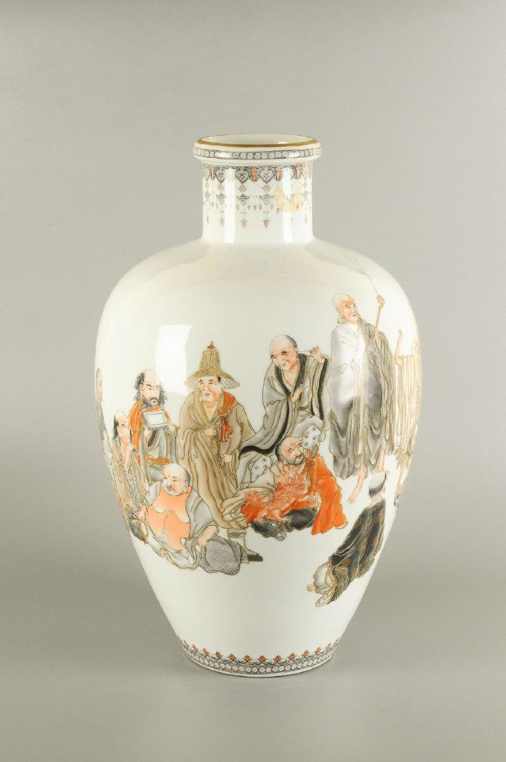 A polychrome porcelain vase decorated with figures, a