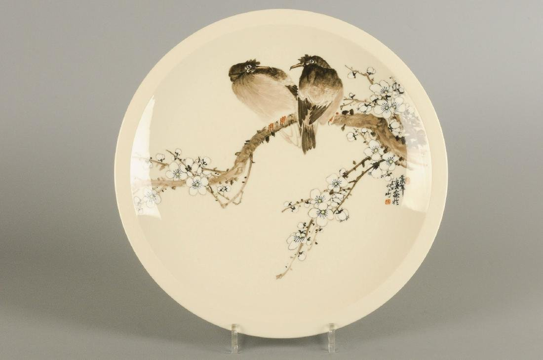 A polychrome porcelain plate decorated with floral
