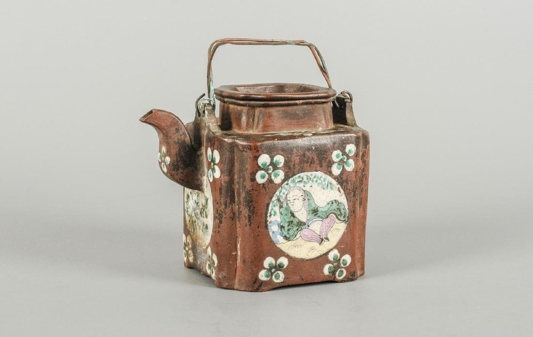 A Yixing teapot decorated with floral design. Marked