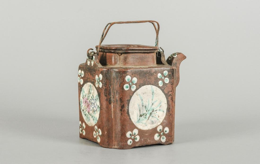 A Yixing teapot decorated with floral design. Marked - 4