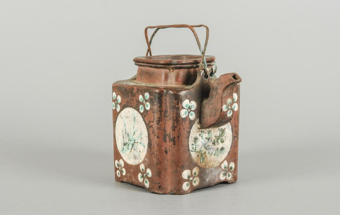 A Yixing teapot decorated with floral design. Marked - 5