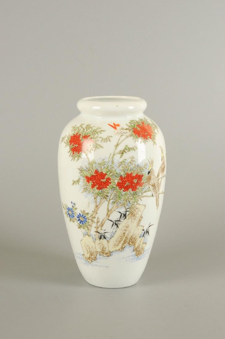 A polychrome porcelain vase decorated with floral