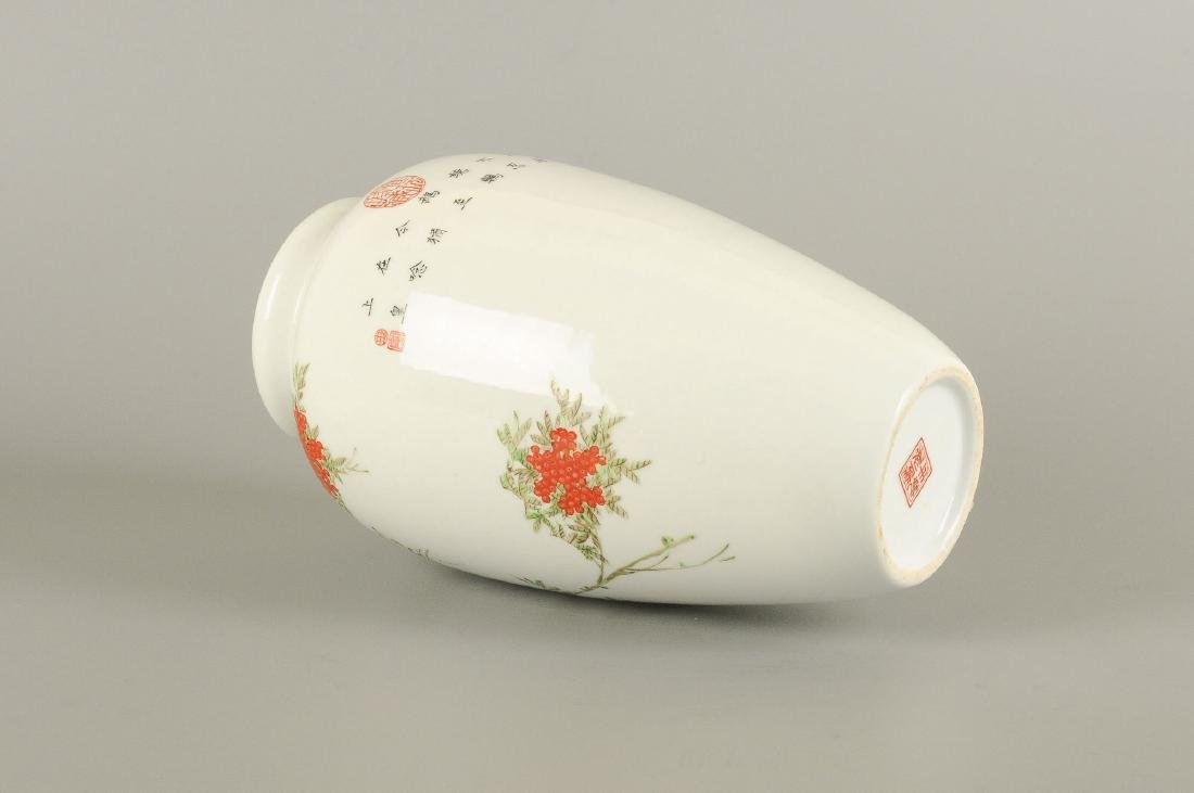 A polychrome porcelain vase decorated with floral - 3