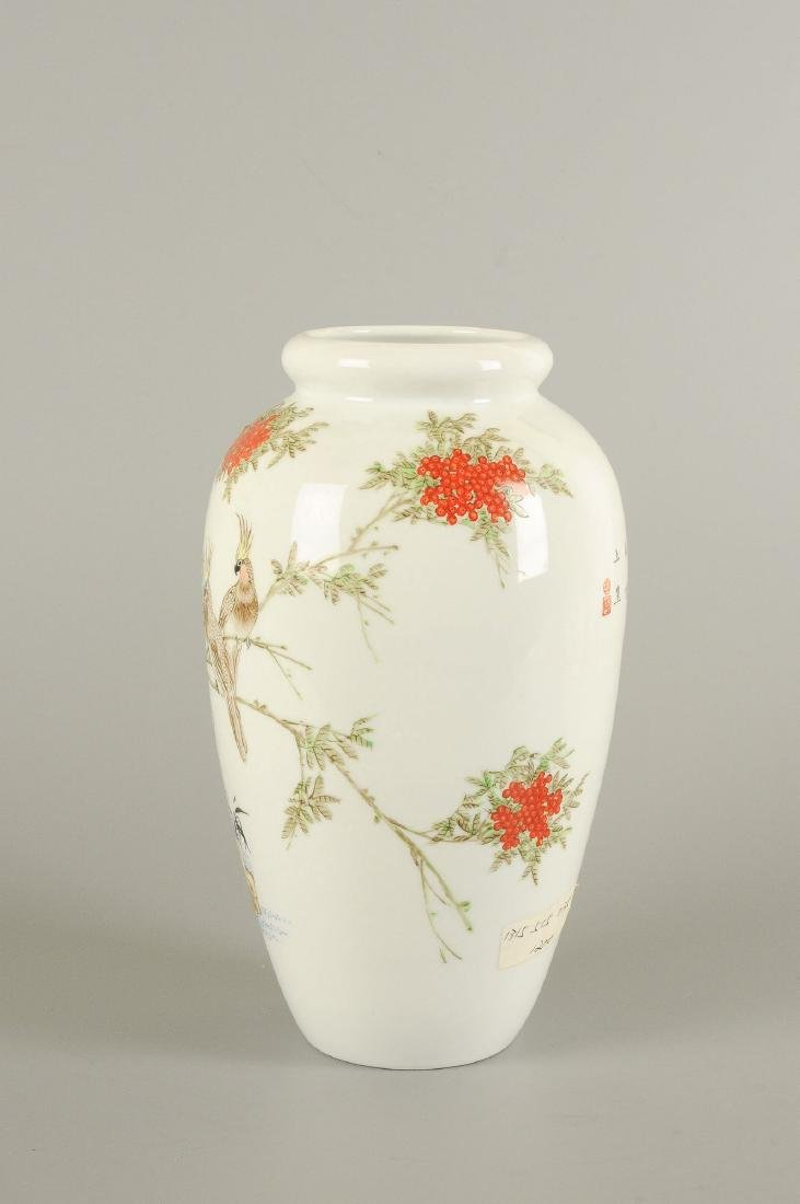 A polychrome porcelain vase decorated with floral - 4
