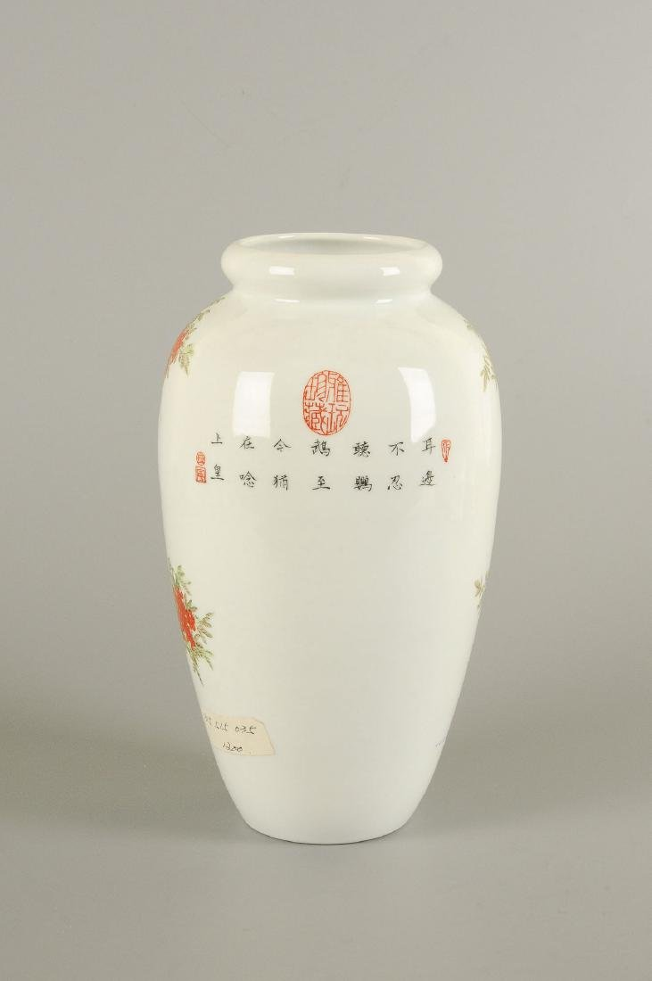 A polychrome porcelain vase decorated with floral - 5