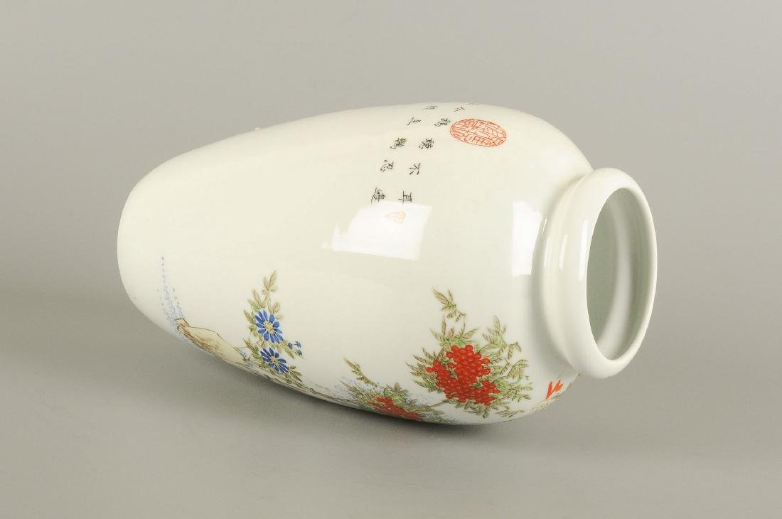 A polychrome porcelain vase decorated with floral - 6