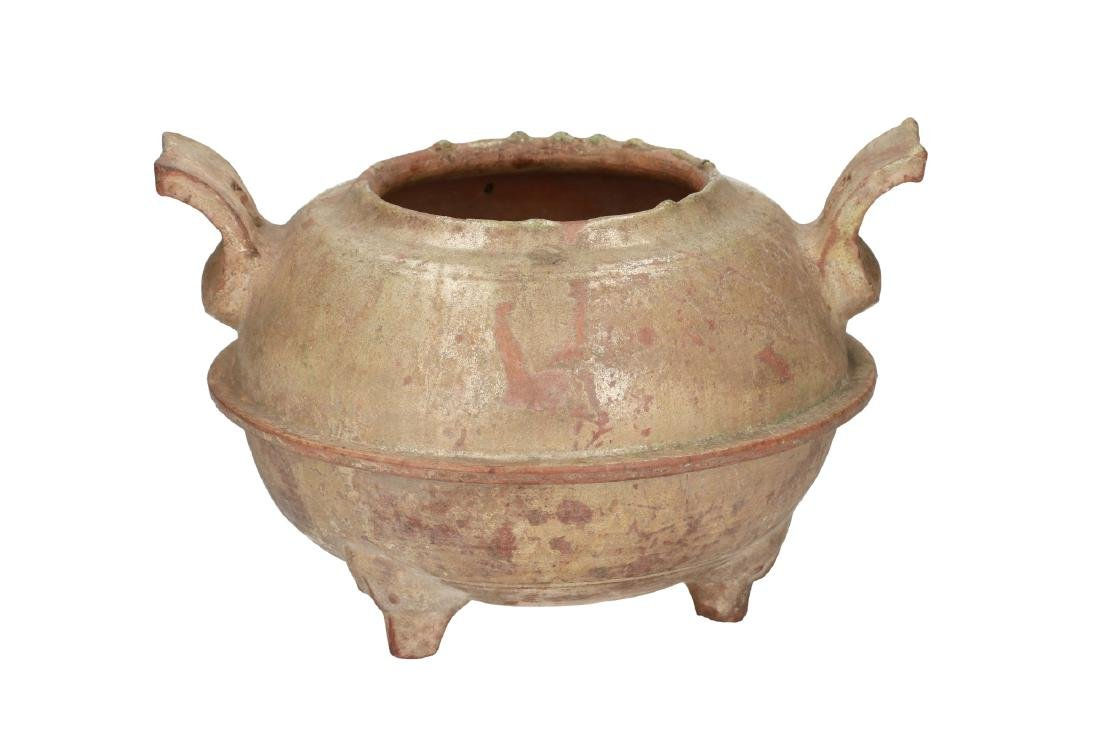 A green glazed pottery iridescent tripod censer. The