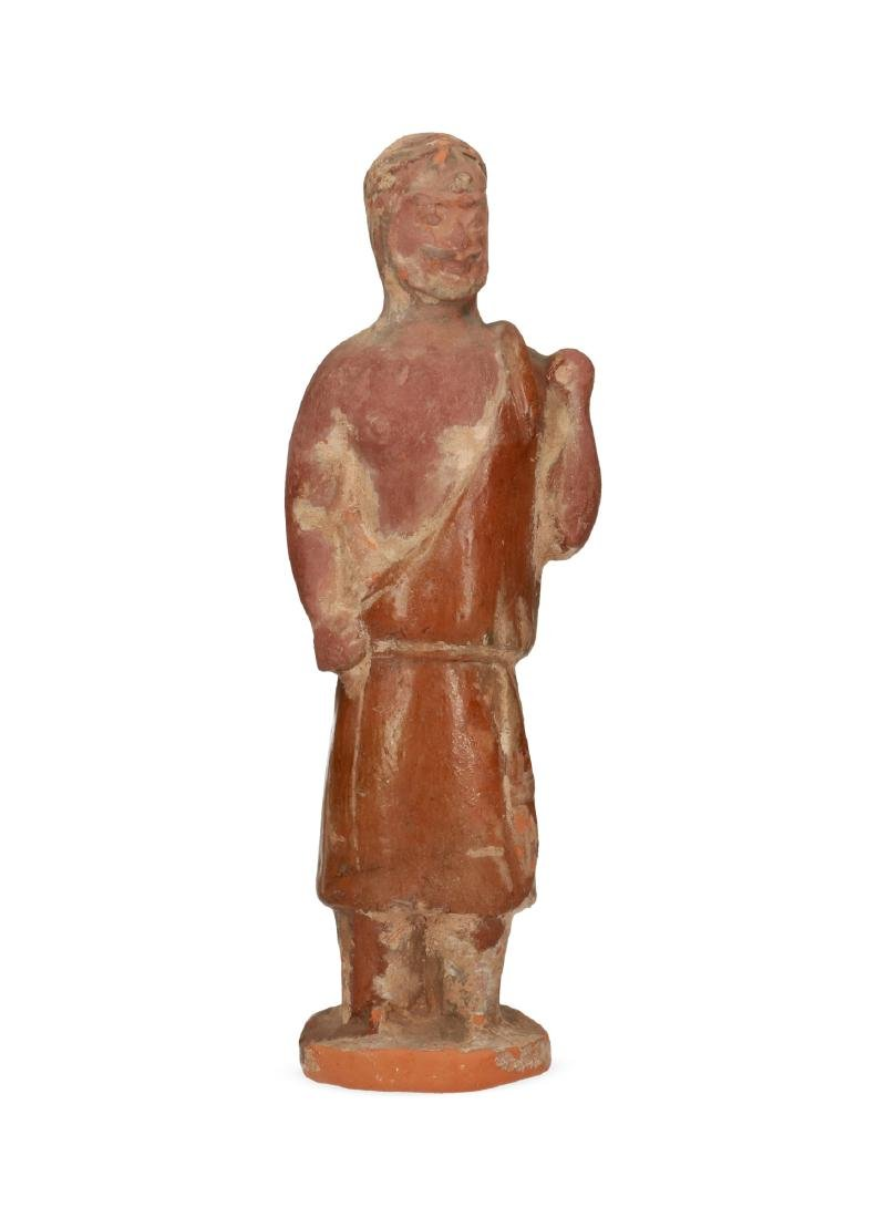 A pottery sculpture of a half nude martial man with