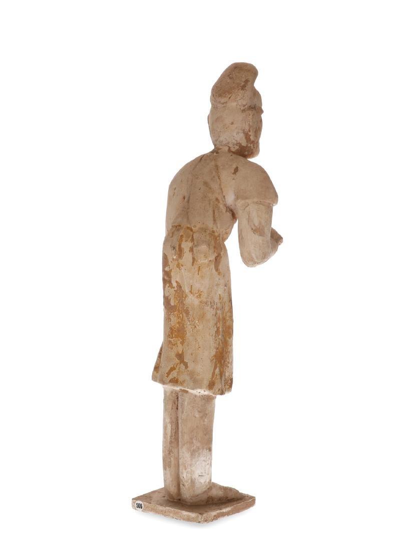 An earthenware unglazed sculpture of a male attendant, - 2
