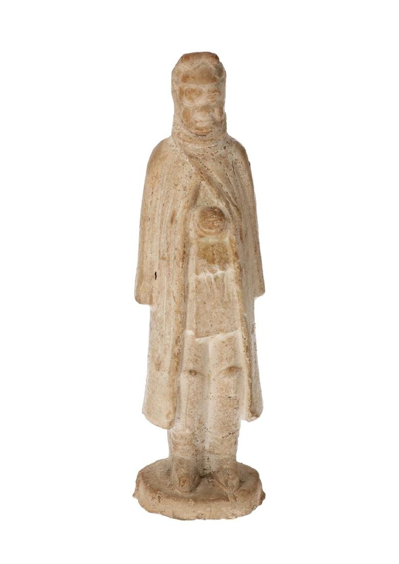 An earthenware standing equestrian with long robe and