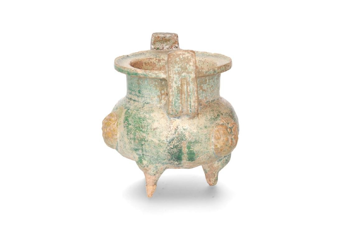 A tripod pottery baluster vessel in the shape of a