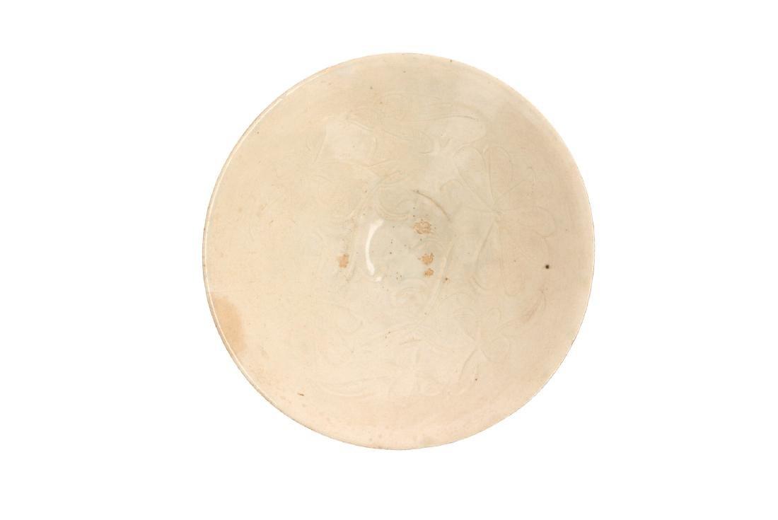 A qingbai porcelain bowl with carved flower decor. - 3