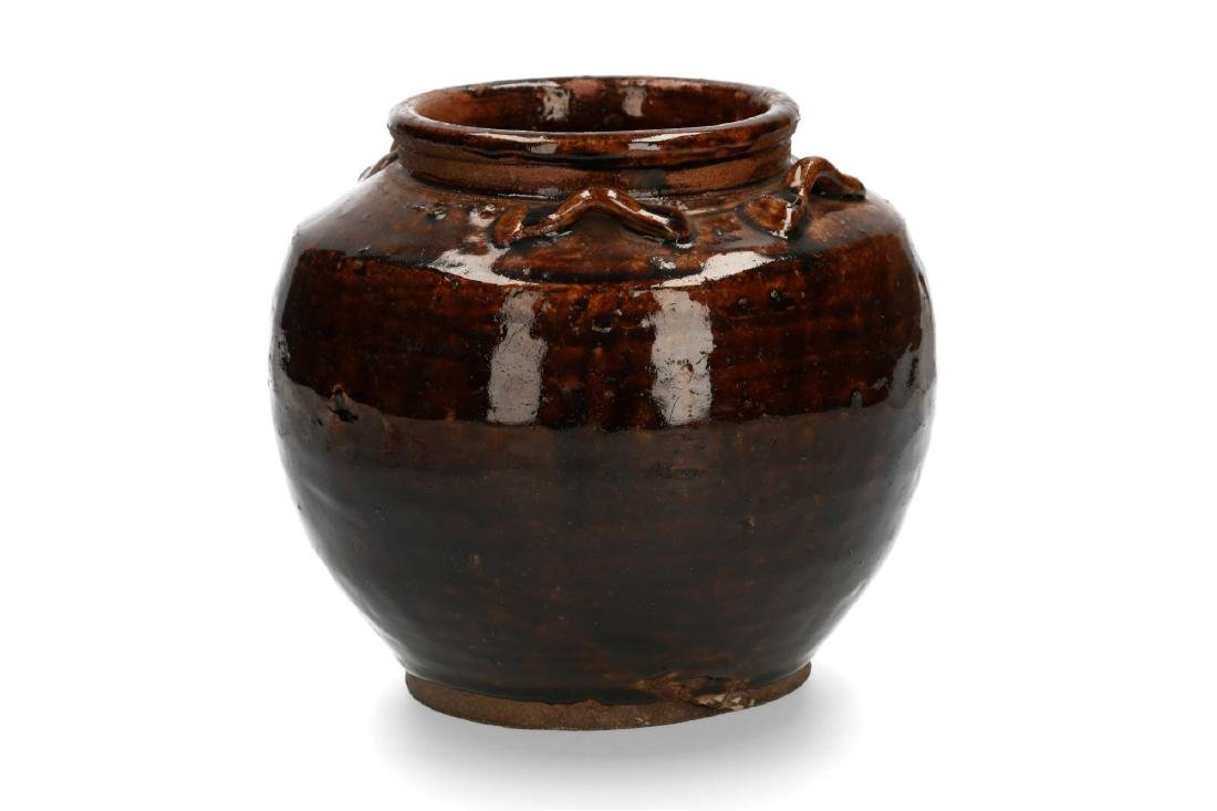 A brown glazed stoneware Martaban storage jar. China,